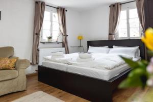 Ein Bett oder Betten in einem Zimmer der Unterkunft Zur Alten Weinkelter - bezauberndes Fachwerkhaus aus der Spätgotik - 500 Jahre alt
