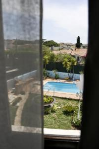 A view of the pool at Casa Teresinha or nearby