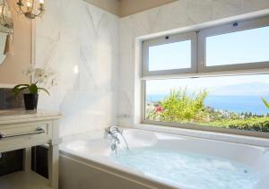A bathroom at Pleiades Luxurious Villas