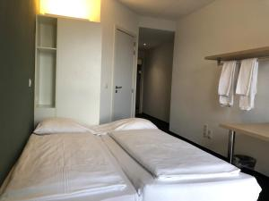 A bed or beds in a room at The ASH