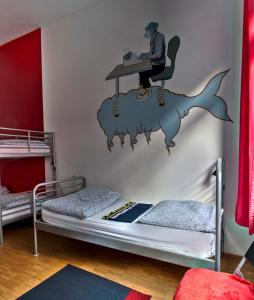 A bed or beds in a room at Heart of Gold Hostel Berlin