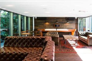 The lounge or bar area at Chapter Lewisham Apartments