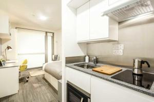 A kitchen or kitchenette at Chapter Lewisham Apartments