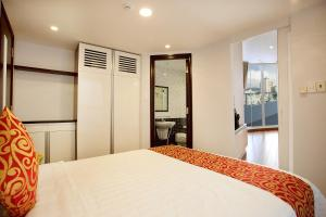 A bed or beds in a room at Galaxy Apartment
