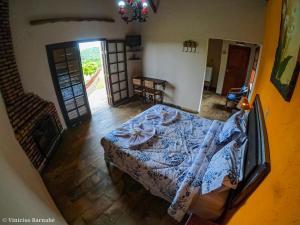 A bed or beds in a room at Pousada Eldorado Das Gerais