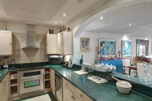 A kitchen or kitchenette at Old Trees 002 by Barbados Sotheby's International Realty
