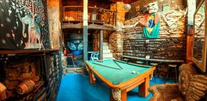 Mesa de bilhar em Uai Hostel