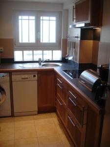 A kitchen or kitchenette at Loft Saint-Michel