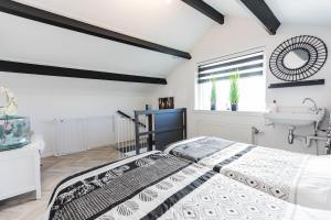 Ein Bett oder Betten in einem Zimmer der Unterkunft Holiday Home Oostkapelle