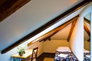 Voodi või voodid majutusasutuse Art Hotell toas