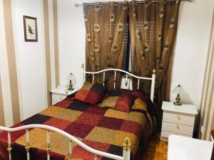 Uma cama ou camas num quarto em Casa de Katiolo