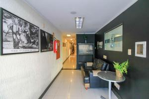 The lobby or reception area at Coral Tower Express Cidade Baixa