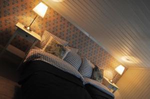 Säng eller sängar i ett rum på Våffelcafé Bed & Breakfast