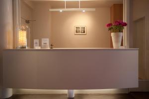 Lobby/Rezeption in der Unterkunft Hotel Van Bunnen