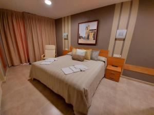 Cama o camas de una habitación en HOTEL RURAL San Pedro