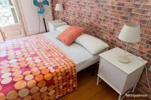 Un ou plusieurs lits dans un hébergement de l'établissement Diagonal House