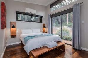 A bed or beds in a room at The Floating Forest Retreat