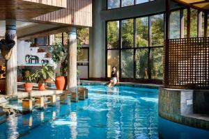The swimming pool at or near Club Himalaya, by ACE Hotels