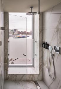 A bathroom at Sir Adam Hotel