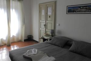 A bed or beds in a room at B&B La Torre Celle Ligure