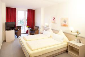 Ein Bett oder Betten in einem Zimmer der Unterkunft Hotel Busch
