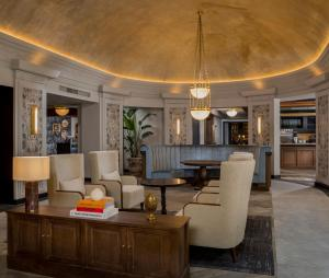 The lobby or reception area at The Queens Hotel