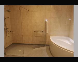 A bathroom at The R Inn Hotel