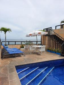 The swimming pool at or near Oceano Copacabana Hotel