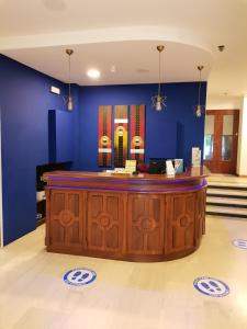 The lobby or reception area at Paradise Hotel