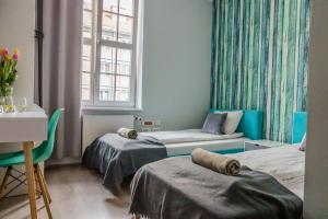 A bed or beds in a room at Trip & Hostel