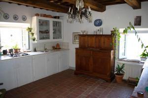 Cuisine ou kitchenette dans l'établissement Villa Gioietta