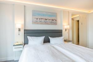 Кровать или кровати в номере Hotel Königslinie