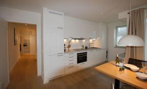 Küche/Küchenzeile in der Unterkunft Viktoraresidenz Wohnung 3