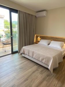 Letto o letti in una camera di Roula Kotsonis Superior Apartment