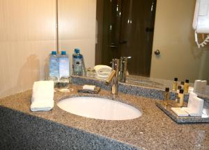 Ein Badezimmer in der Unterkunft NM Lima Hotel