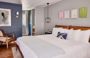 A bed or beds in a room at Journey East Hampton