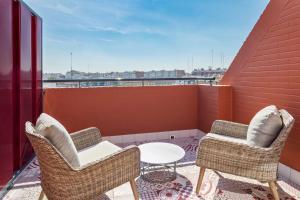 A balcony or terrace at Eurostars Guadalquivir