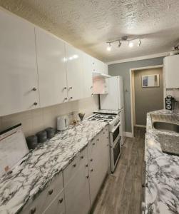 A kitchen or kitchenette at Orpington-Kent