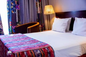 A bed or beds in a room at Sultani Hotel