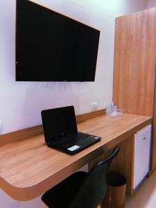 A television and/or entertainment centre at Hotel Amália