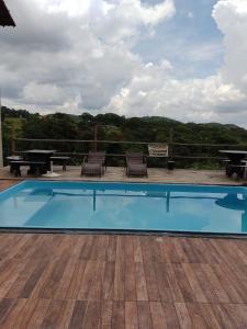 The swimming pool at or near Pousada Só Alegria