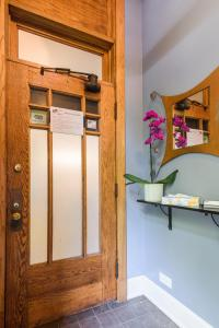 A bathroom at House 5863- Chicago's Premier Bed and Breakfast