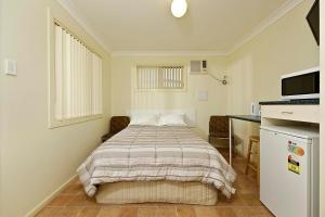 A bed or beds in a room at Mudgee Valley Park