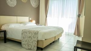 A bed or beds in a room at Residence Modus Vivendi