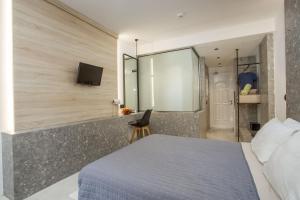 En eller flere senger på et rom på Dias Studios & Suites