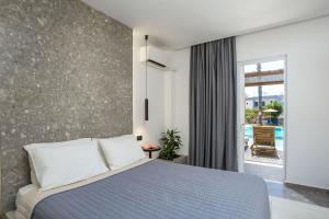 Łóżko lub łóżka w pokoju w obiekcie Dias Studios & Suites
