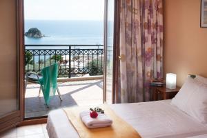 Letto o letti in una camera di La Luna Hotel