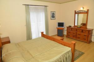 A bed or beds in a room at Hotel Venezia Imotski