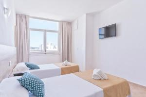 A bed or beds in a room at Suncoast Ibiza Hotel - Adults Only -