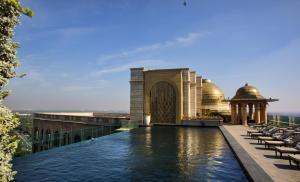 The swimming pool at or near The Leela Palace New Delhi